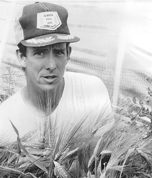 Bart Hall in one of his hull-less barley breeding plots in 1985. Photo courtesy of Bart Hall.