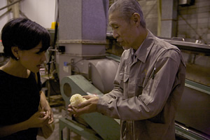 Toshio Sumiya (right,) president of the Sumiya Bunjiro Brewery Co., Ltd., shows Kazuko Moriyama, OCIA Japan's representative director, glutinous rice ready for brewing into mirin at his facility in Hekinan city, Aichi, Japan on May 19, 2014. Photo by Demetria Stephens.